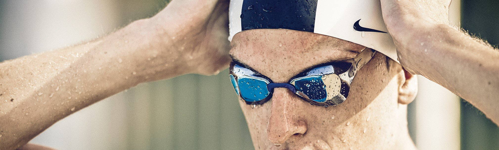 Mirrored goggles and Nike Swim cap
